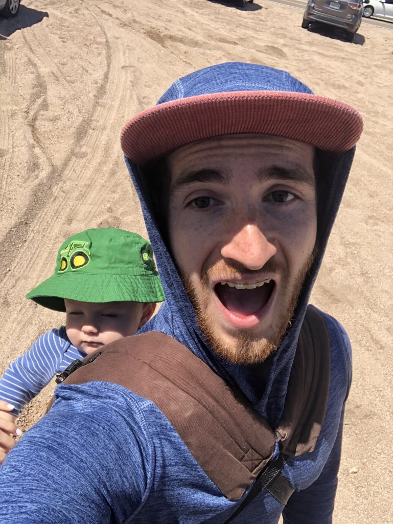 My son in a baby carrier, we're about to head out on the trail.